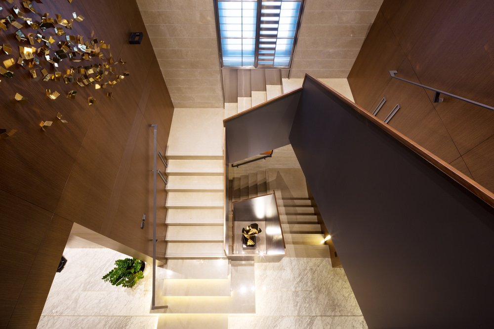 This home offers a beautiful and smooth white flooring and staircase steps leading to the home's second floor landing.