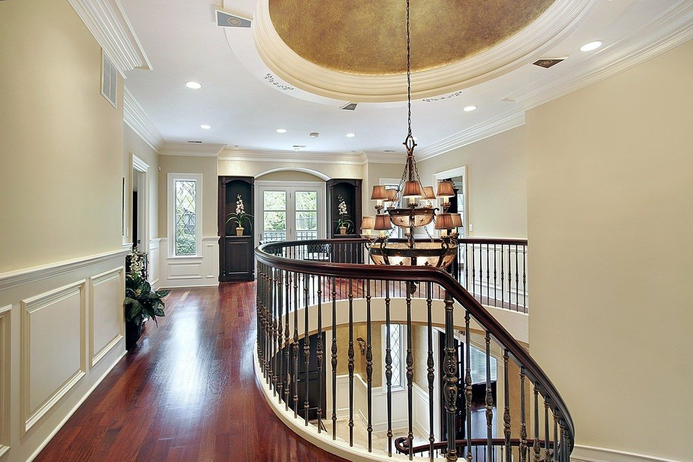 This home offers an elegant second floor landing. The staircase lighted by a beautiful chandelier leads to the home's second floor hallways with a hardwood flooring.