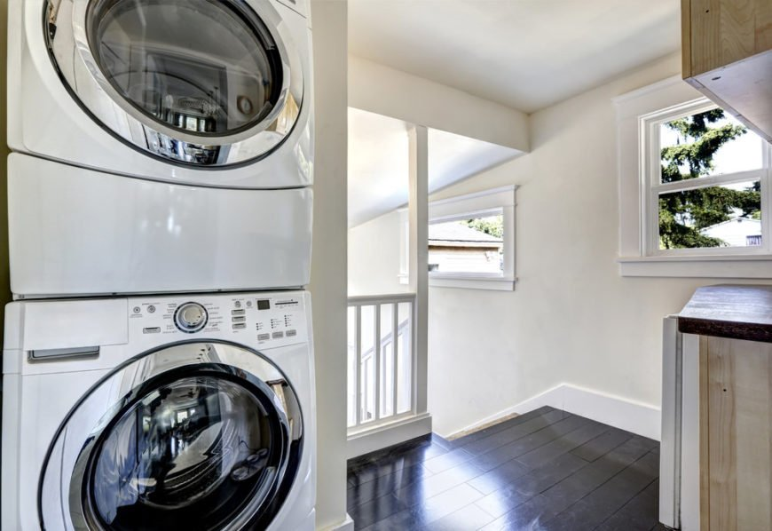 Small laundry room closet on landing.