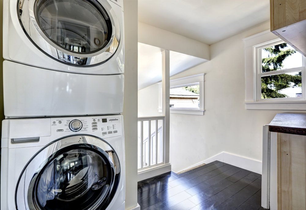 Small laundry room closet on landing.