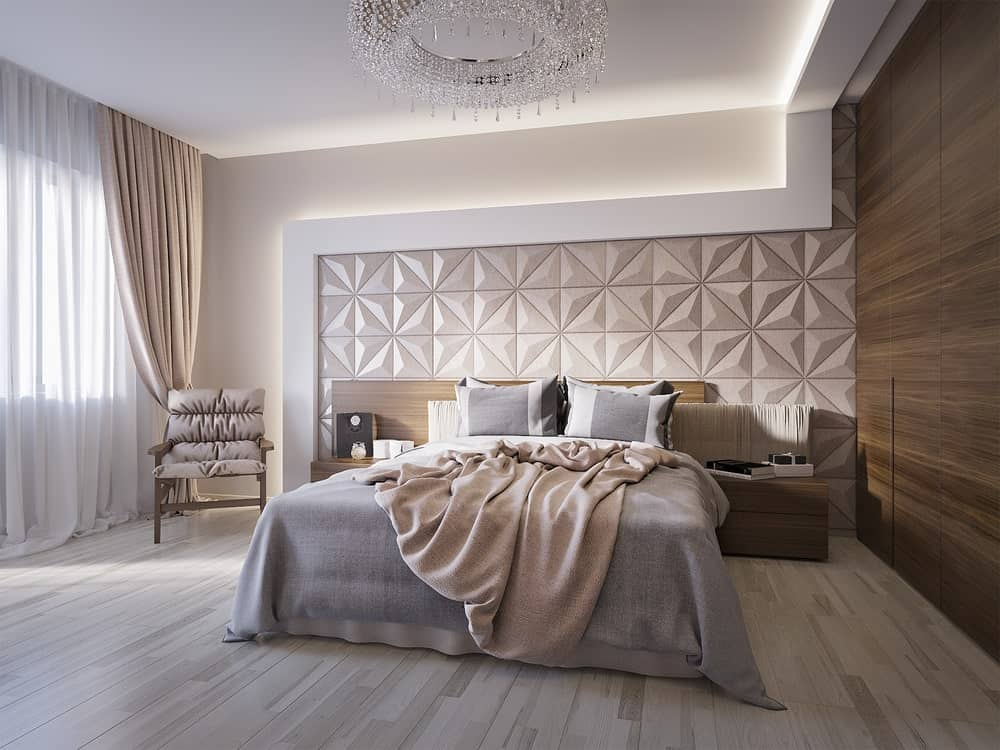 Elegant primary bedroom features a gorgeous textured accent wall with strip lights and custom built-in headboard that extends as a side table.