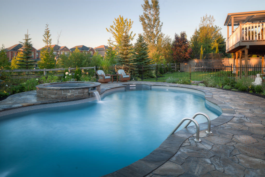 This home boasts a swimming pool in the middle of the beautiful garden area.