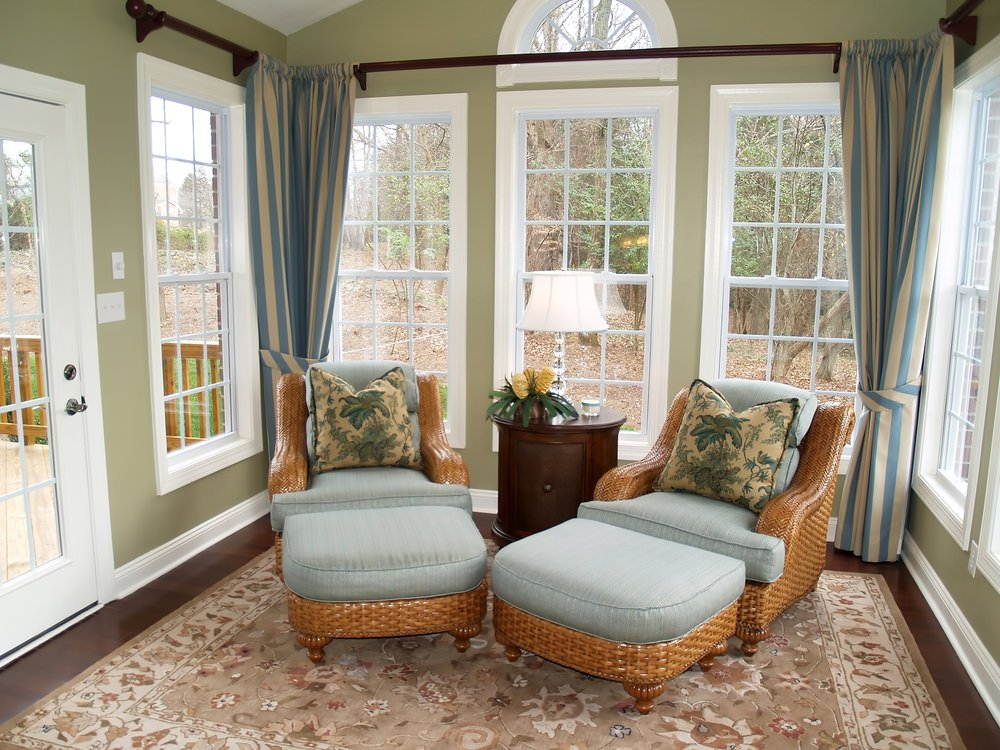 Medium-sized room in a country-style aesthetics. The hardwood floor is carpeted for that beautiful and elegant finish.