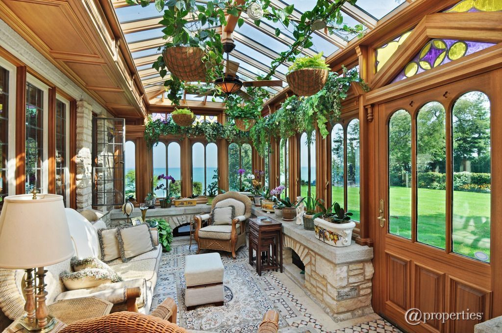 This tropical sunroom looks like a mini mansion dominated with fresh plants.