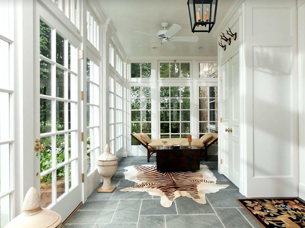 Minimalistic sunroom in neutral colors.