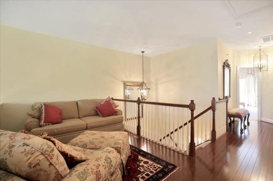 This home offers a living room set on the second floor landing featuring a sparkling hardwood flooring.