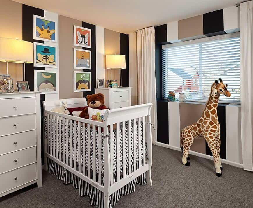 Classy nursery room with stylish walls and carpet flooring.