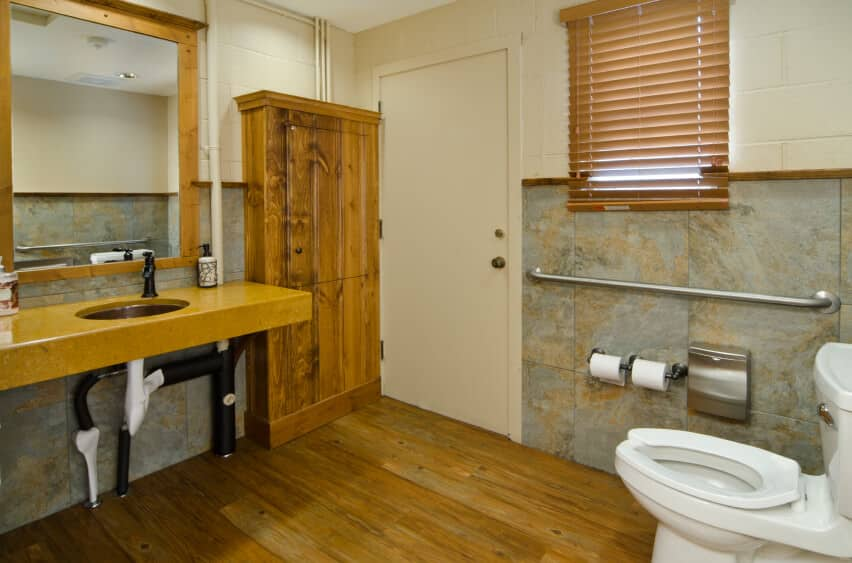 Master bathroom with a floating vanity sink counter and hardwood flooring.