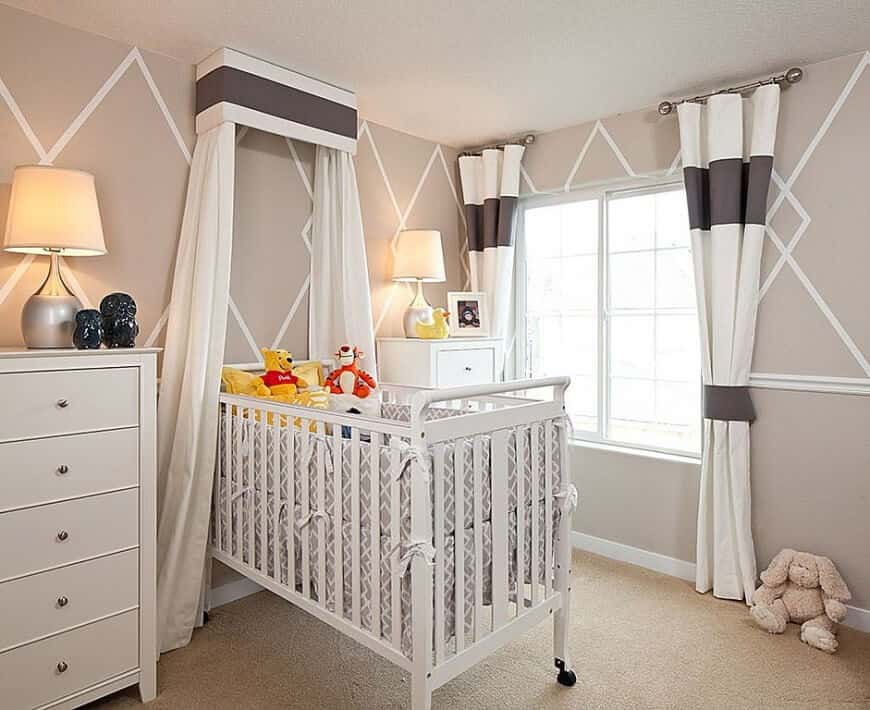 Nursery room with stylish walls and carpet flooring.