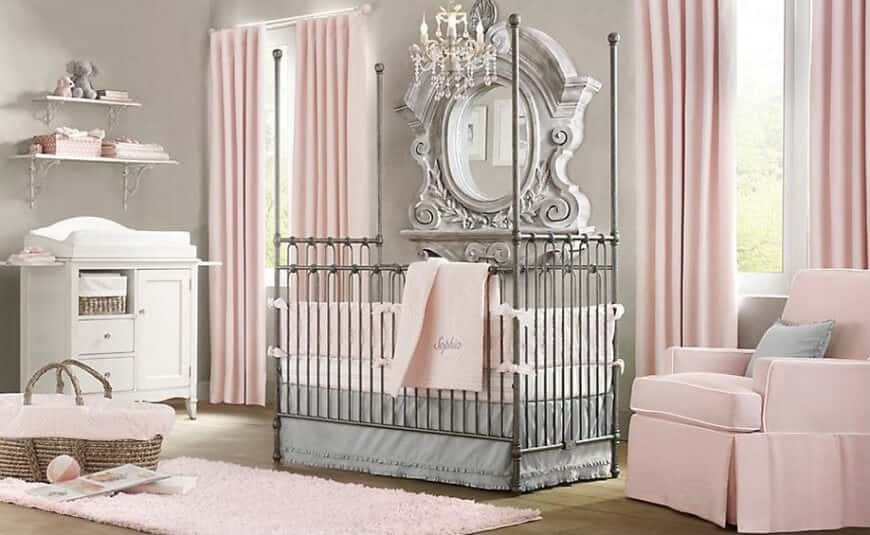 This baby girl nursery room is not just girly, it's stylish as well. The crib looks unique while the mirror looks stylishly elegant. The pink curtains matches with the rug and the club chair.