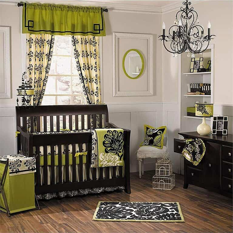Nursery room with classy curtains, baby bed, pillows, blanket and rug.