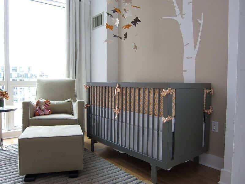 Modern nursery room with stylish wall design and a crib matching the rug.
