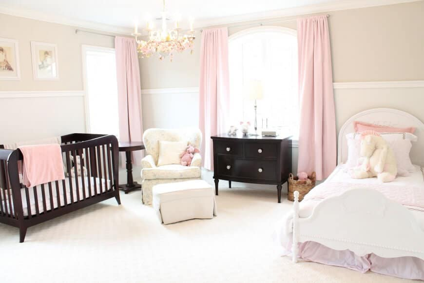 This bright nursery room will surely help brighten the mood of your baby girl. The white walls and floors blends well with the pink details of the room.