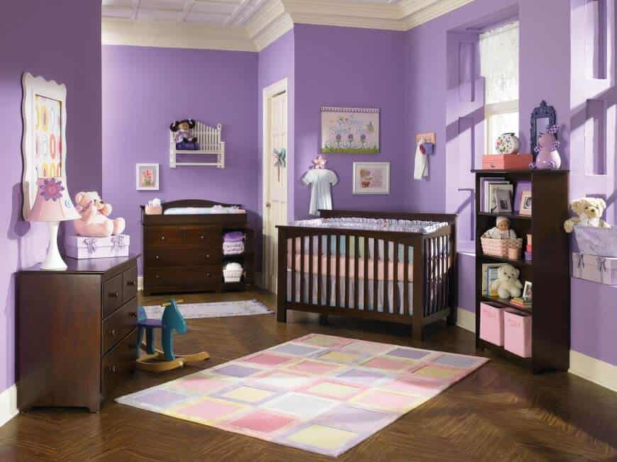 Purple look is another way to catch the eyes of your baby girl. This nursery room is filled with pink and purple colors, from walls, stuff toys, lamps down to the rug.