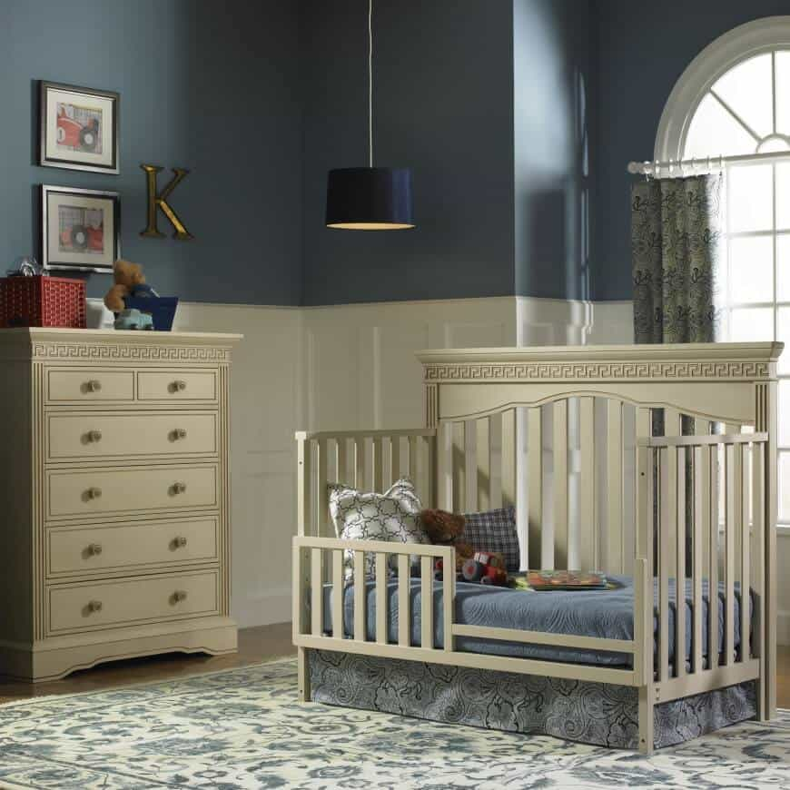 This nursery features gorgeous wooden furniture placed in contrast to rich, navy blue walls. The finish is sophisticated and a blend of traditional and modern design. The minimalist approach makes it look like a room that can easily be converted into an adult bedroom as time goes by. But the playful touches in accessories keep it looking youthful.