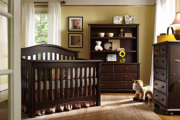 This room uses a gender neutral color palette of rich, coffee colored wood and yellow for a rich, sophisticated finish. The use of wood in a baby's room may seem like a bolder choice as opposed to using lighter and trendier colored materials but it's sturdy and looks incredibly elegant without ever going out of style.