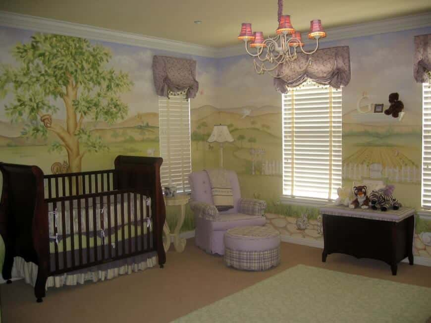 Artistic wall design on this nursery room with a carpet flooring and a rug.
