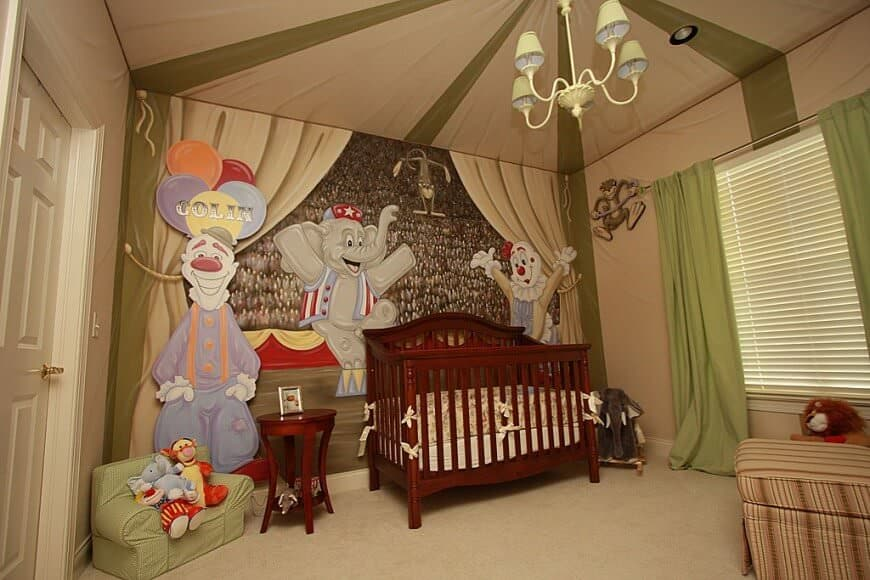 Carnival-themed nursery room with clowns and an elephant wall decor along with a carpet flooring.