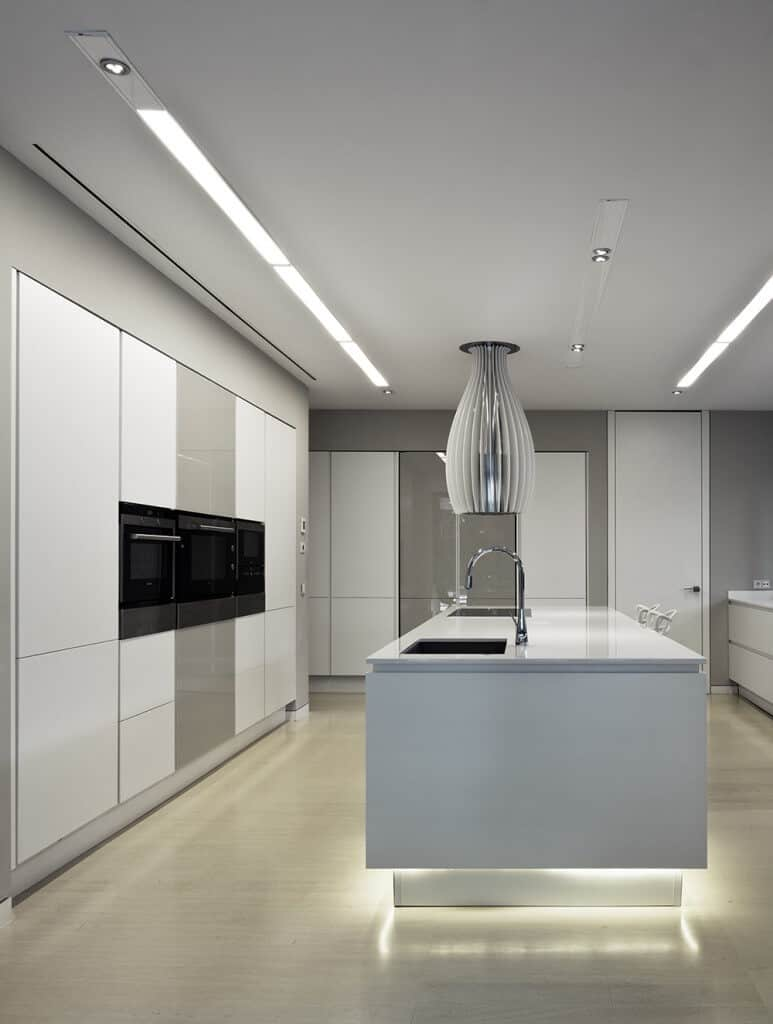 Modern kitchen featuring a classy center island with a breakfast bar set on the nice flooring. The ceiling lights add style to the room.