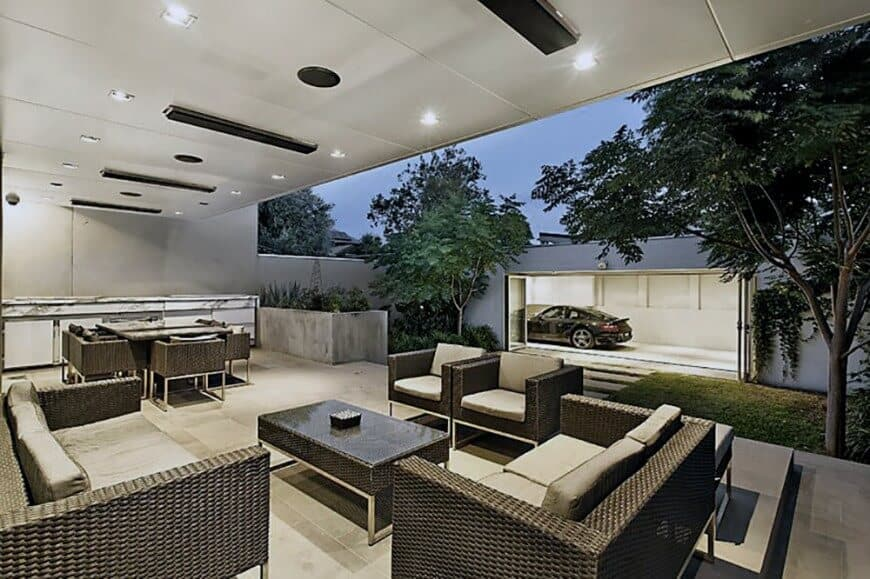 This stylish patio together with the outdoor kitchen and dining is accessible from the home's garage.