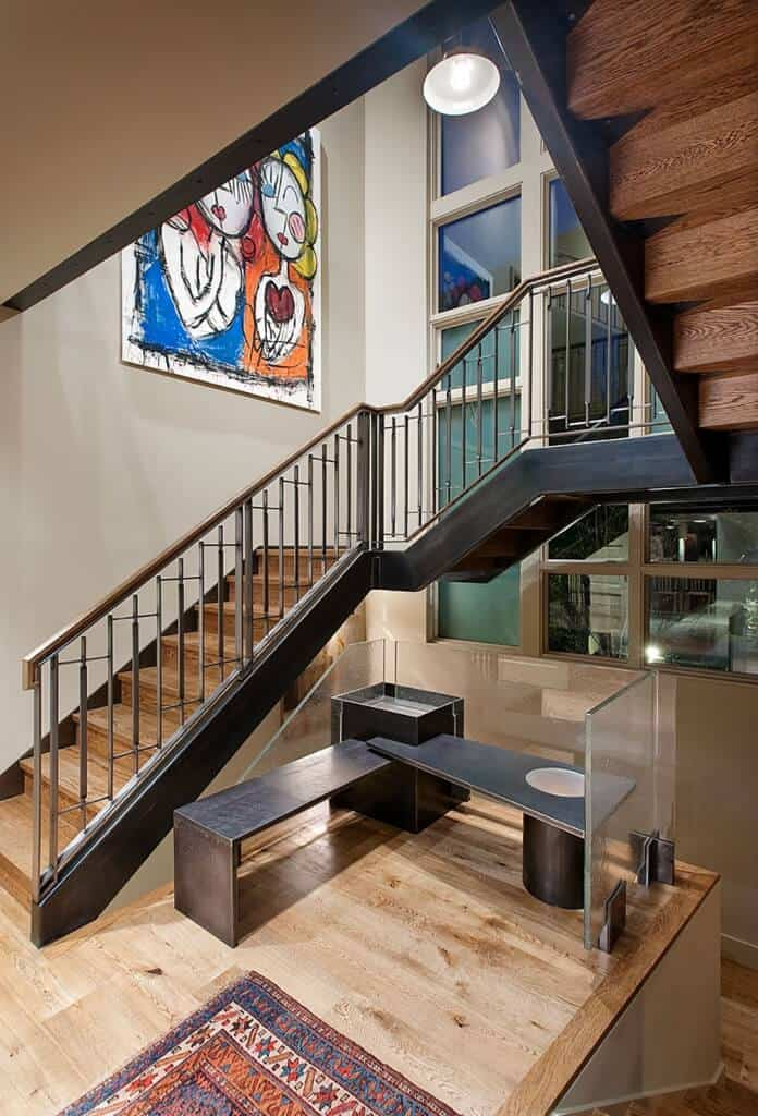 Mid-sized stairs with space consideration in mind, featuring steel hand railings and wooden steps.