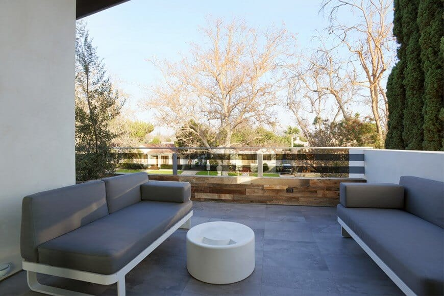 This second floor patio area offers a comfortable sofa set with a white center ottoman table.