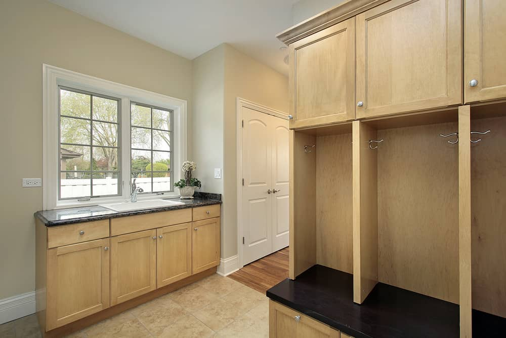 Mudroom with built-in oak lockers and sink.