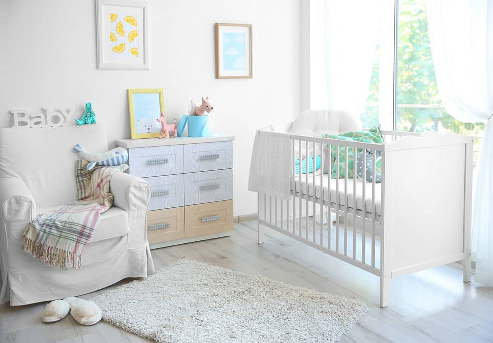 Nursery room featuring a hardwood flooring and white walls.