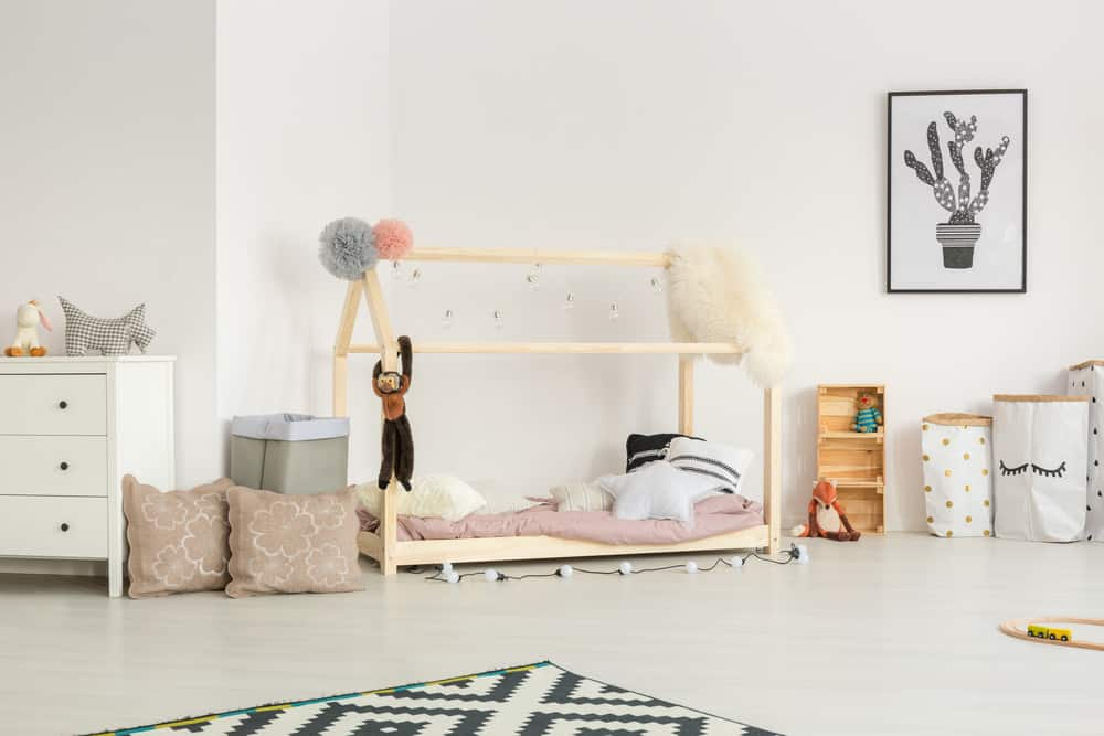Nursery room with white walls and small furniture for kids.