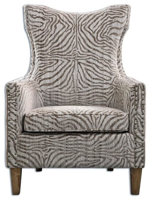 Highback armchair with beige zebra print.