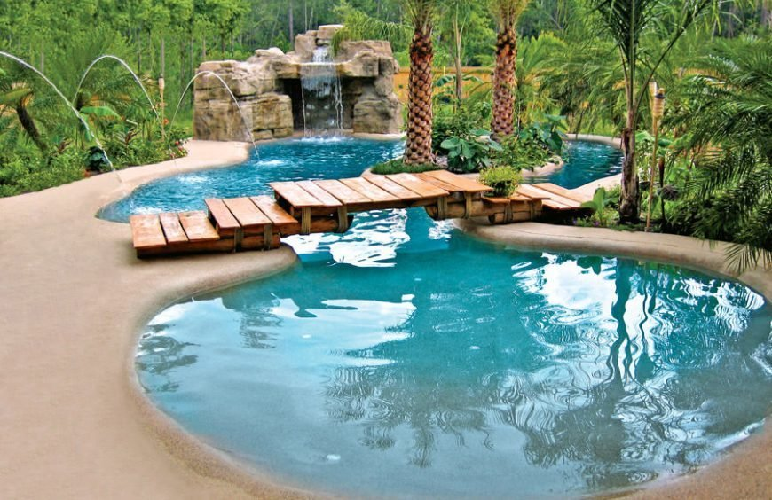 Amazing Zero Entry Backyard Swimming Pool With Waterfall And Bridge.