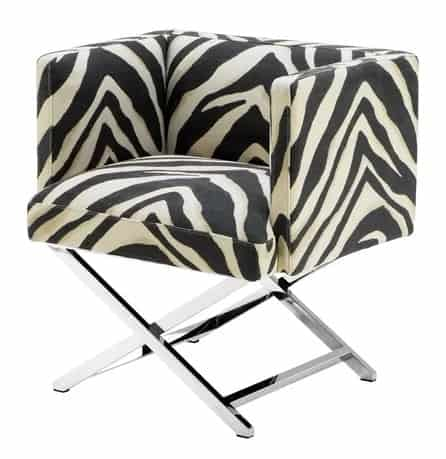 An accent chair with a metal base and zebra print fabric.