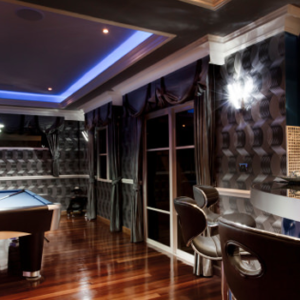 Fun-game and entertainment room with dark wood floor and pool table