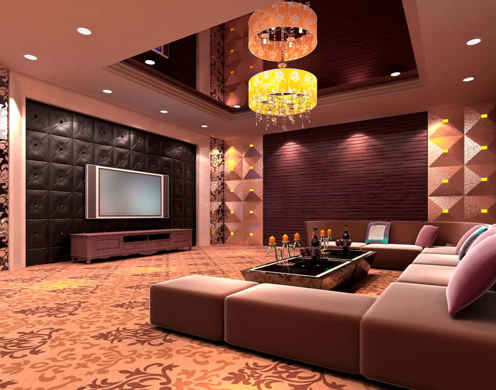 A media room in a contemporary style looking sophisticated with its sleek couches and sound-proof walls.