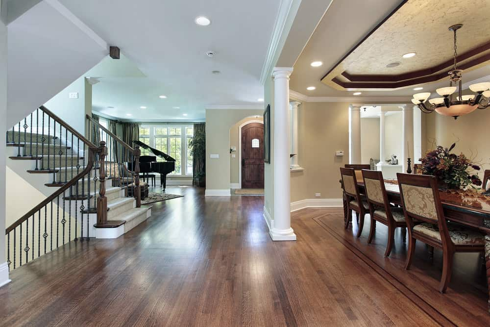 This second floor landing features a hardwood flooring. Greeted by the gorgeous dining table set lighted by a pendant light and recessed lights, this landing look so beautiful.