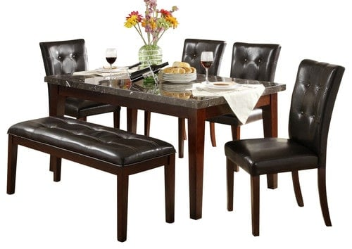 Dining set that includes a rectangular table with a marble tabletop and tufted dining chairs and bench.