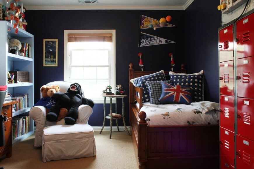 Small boy's bedroom with stylish walls and designs. It also features carpet flooring.
