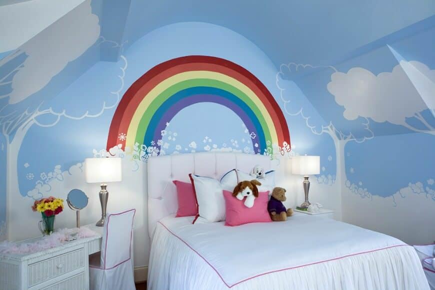 This girl's bedroom boasts cute blue sky walls with white clouds and trees, along with a rainbow near the bed's head.