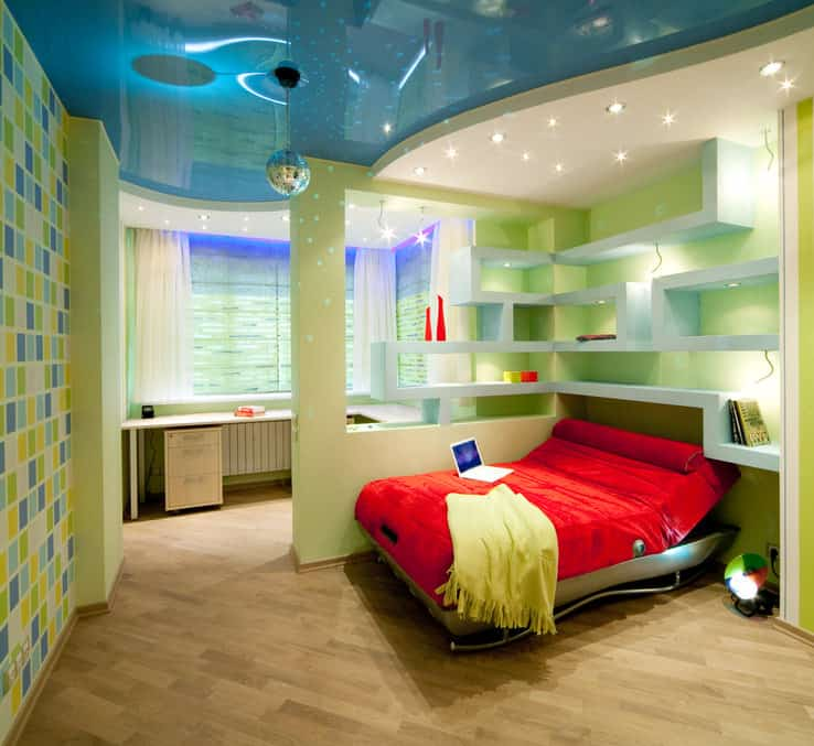 A stunning boy's bedroom with beautiful walls and lights. The hardwood flooring looks classy as well. The bed features an awesome design.