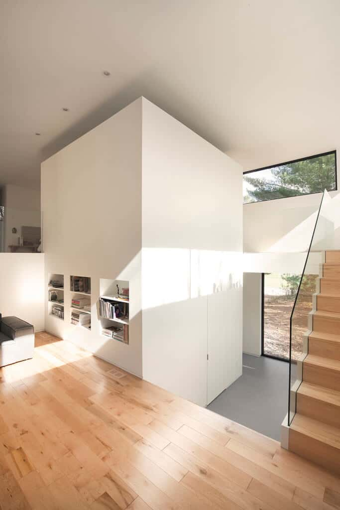 This modern home features a classy second floor landing featuring a hardwood flooring and a hallway that leads straight to home's small library.