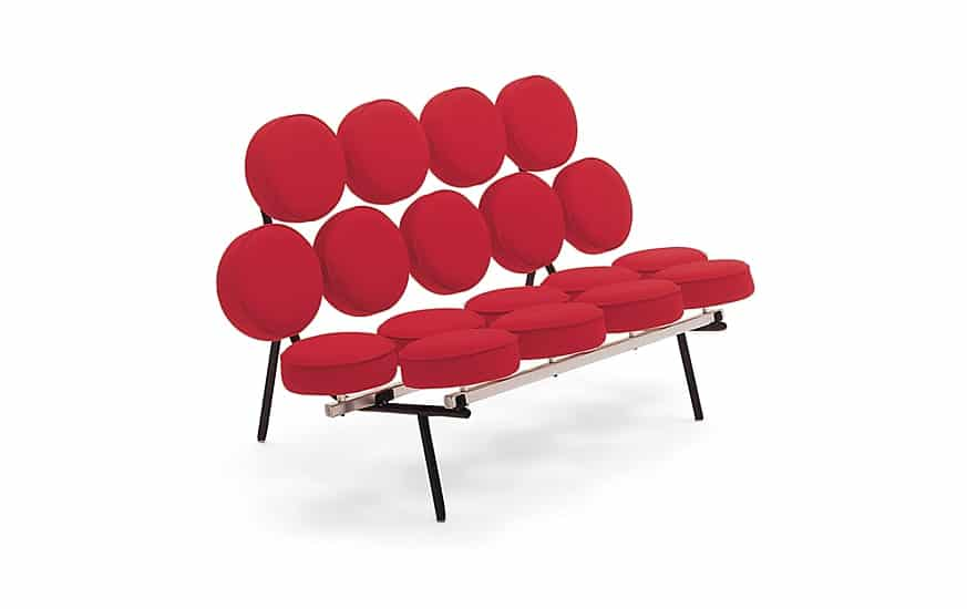 Iconic sofa made of marshmallow-like upholstered cushions attached to steel frame and legs.