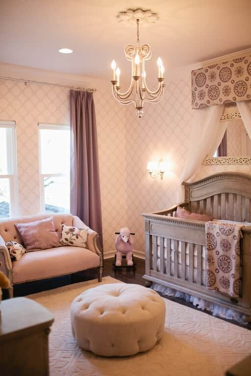 An elegant nursery room for your new born princess. The walls are glamorous while the rug perfectly fits in. The addition of toys and other furniture are well placed while the chandelier creates a classy feel while inside.