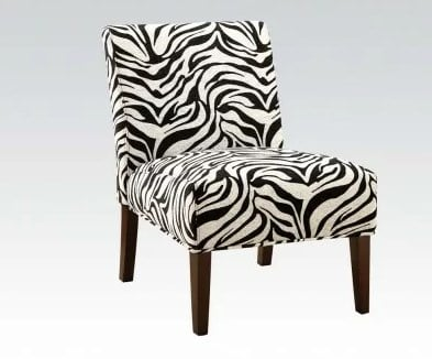 Slipper chair upholstered in polyester blend that features a zebra pattern.