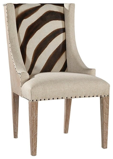 Accent chair with a leather zebra print seat and a unique wood frame.