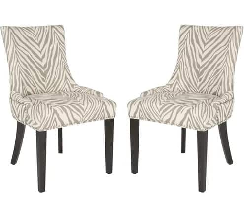 Side chairs with tall seat and backrest, curvaceous figure, and sleek birch wood legs.