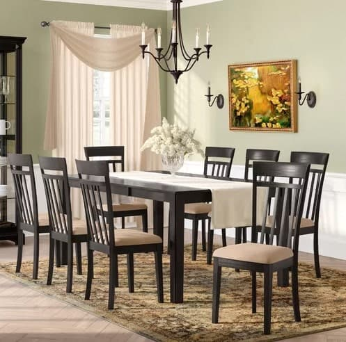 9-piece dining set with mission style chairs and a rectangular table with a butterfly leaf.