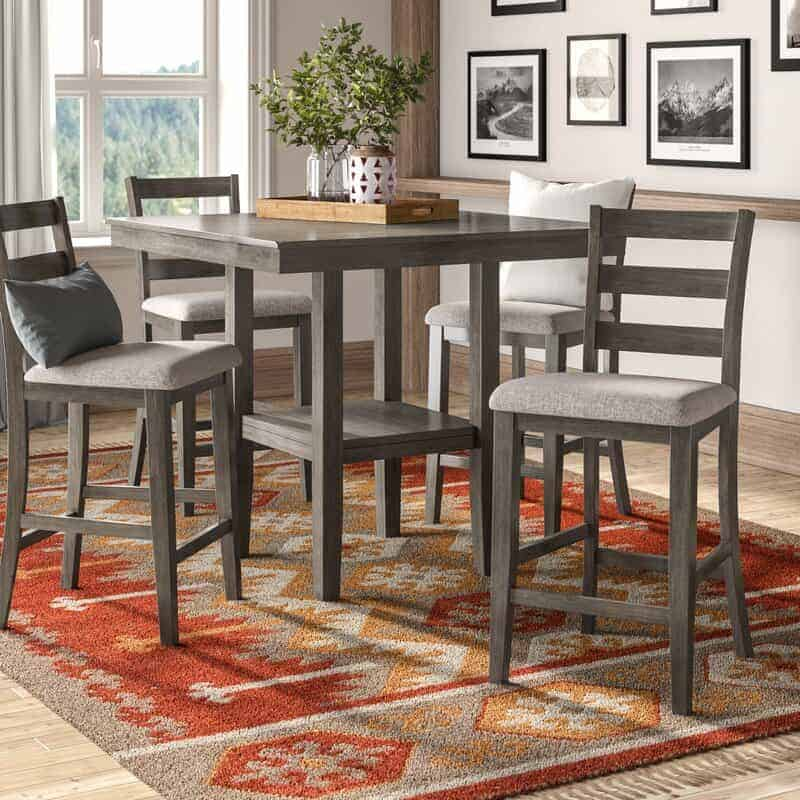 The Sela Five-Piece Counter Height Dining Set from Wayfair.