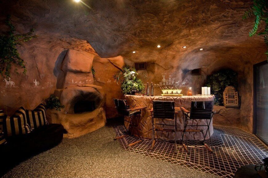 I just had to include this example in our man cave design collection because it's literally designed as a cave with a bar and seating. Somebody interpreted the concept of man cave literally and created a cave. It's kinda cool... but wouldn't be my first pick.