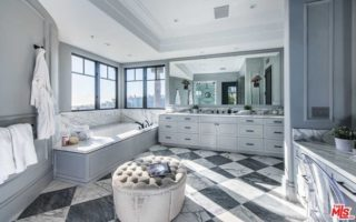 Contemporary gray and white bathroom design with tray ceiling.