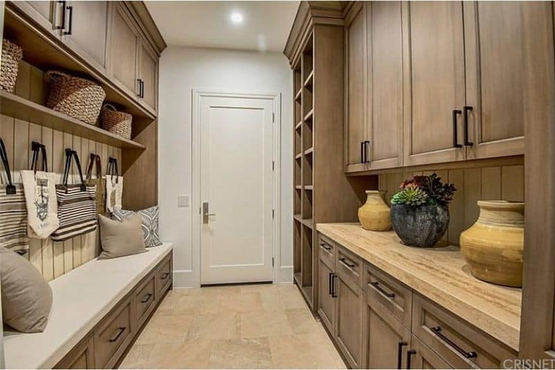 Plain and simple brown mudroom with tiled floor.